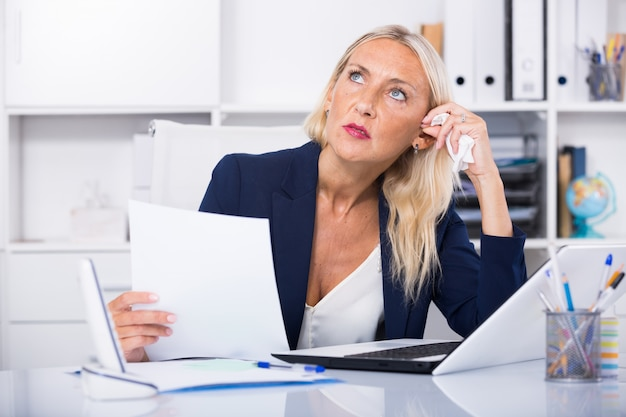 Worried female manager in office