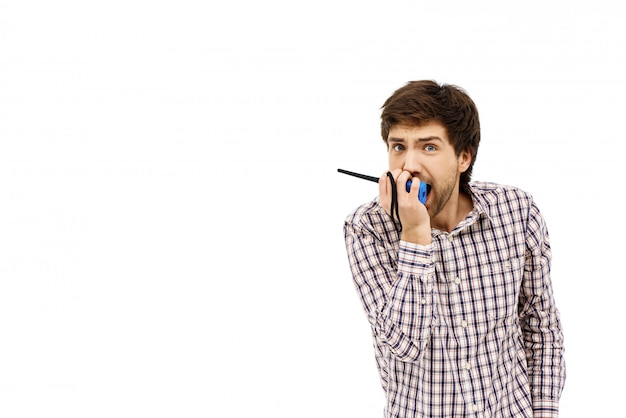 Worried guy send sos via walkie-talkie