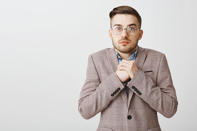 Worried insecure employee in suit looking in panic, being guilty in something