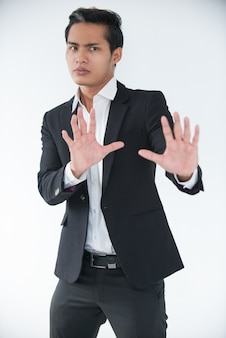 Worried manager raising hands to avoid conflict
