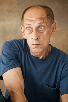 Worried mature man sitting and thinking about something
