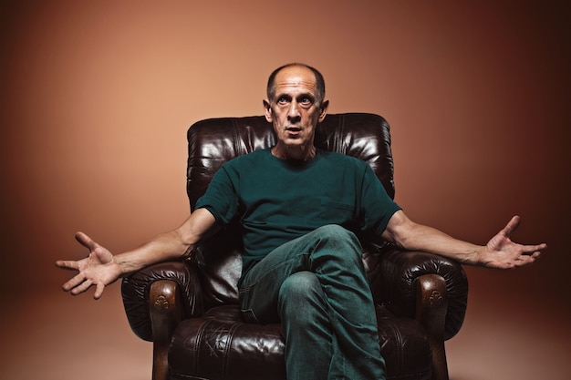 Worried mature man sitting