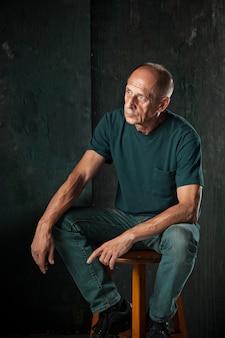 Worried mature man sitting