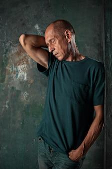 Worried mature man standing at studio