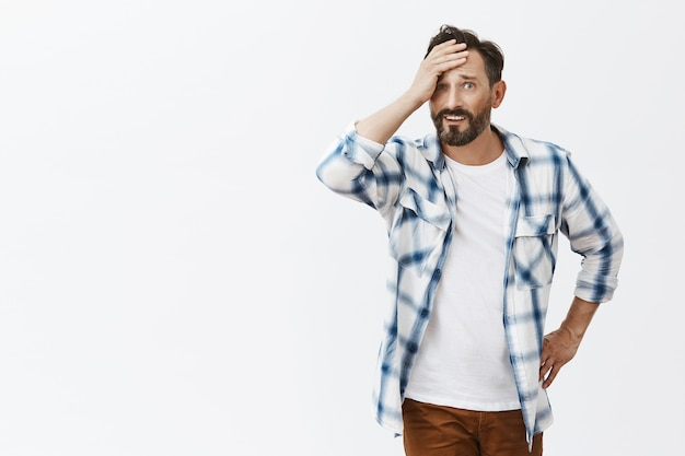Worried and stressed-out bearded mature man posing