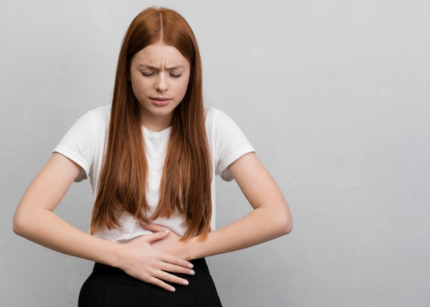 Worried woman having stomachache