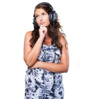 Worried woman listening to music