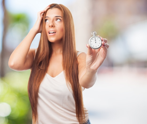 Worried woman with timekeeper