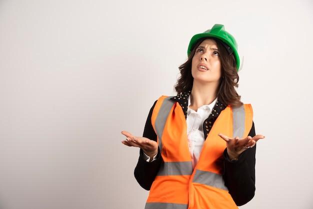 Worried woman worker looking upside