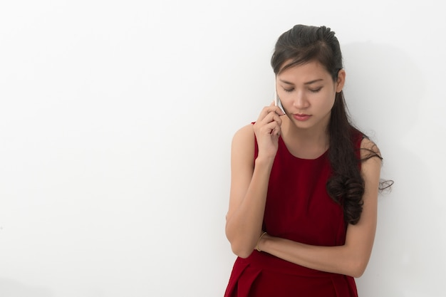 Worried young asian business woman with phone