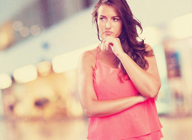 Worried young woman thinking