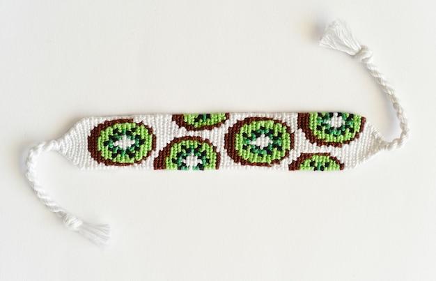 Woven diy friendship bracelet with kiwi pattern