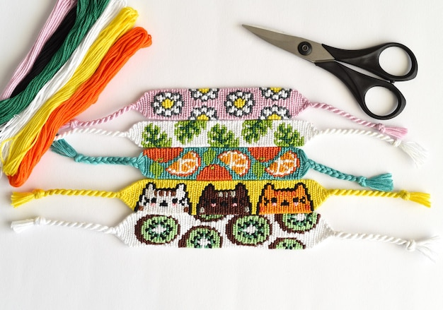 Woven diy friendship bracelets handmade of embroidery floss with knots alpha patterns