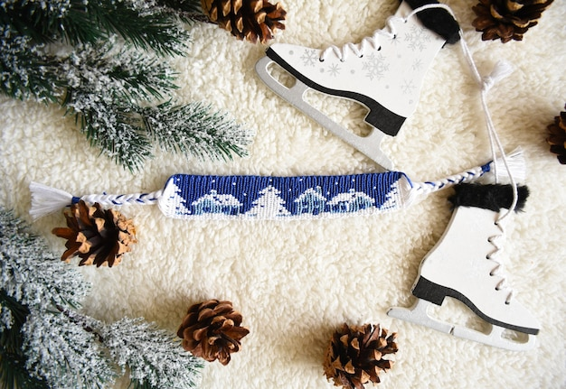 Woven friendship bracelet with alpha pattern snowy night with houses