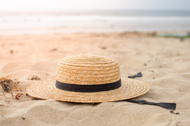 Woven hat left on the beach