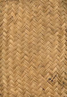 編まれた軽い竹マットテクスチャ背景