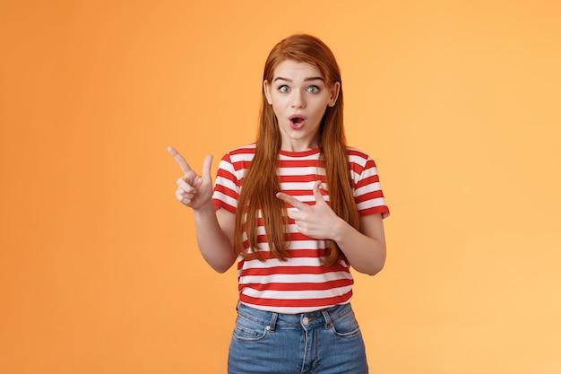 うわーすごい感動興奮した美しい赤毛の女性は驚いたように見えます驚くべきニュース凝視カムを説明します...