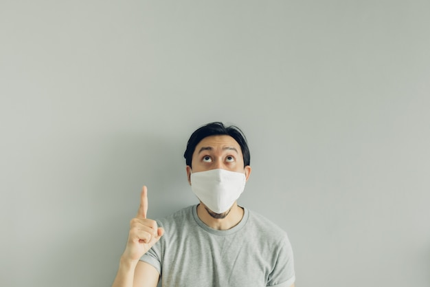 Wow face of man wearing hygienic mask and grey t-shirt.