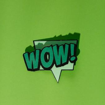 Wow! speech bubble in retro style on dark green backdrop