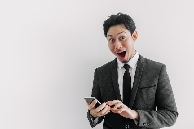 Wow and surprised face of businessman use trade application on the phone