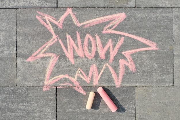 Wow written on gray sidewalk, top view
