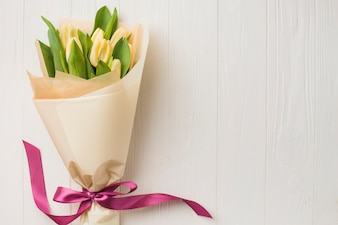 Wrapped bouquet of tulips