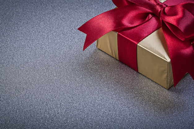Wrapped boxed gift on grey surface