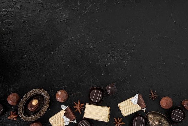 Wrapped chocolate bars and candies with copy space