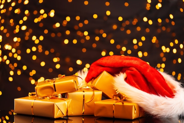 Wrapped christmas gifts on golden lights bokeh