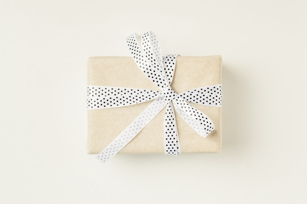 Wrapped gift box with ribbon bow on a white background