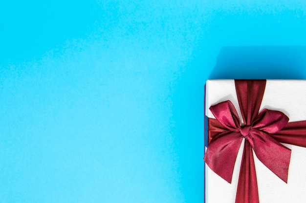 Wrapped gift with ribbon copy space