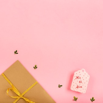 Wrapped gifts on pink background with copy space