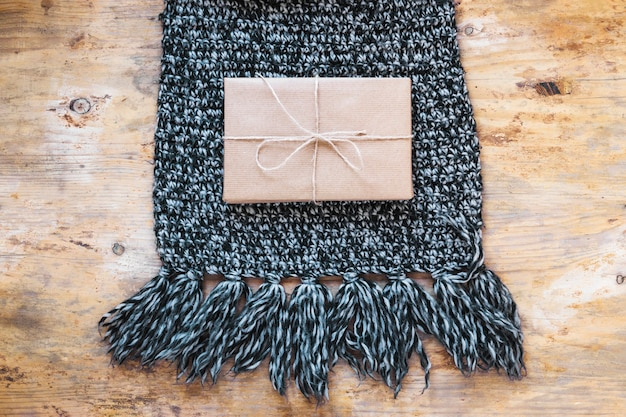 Wrapped present on scarf
