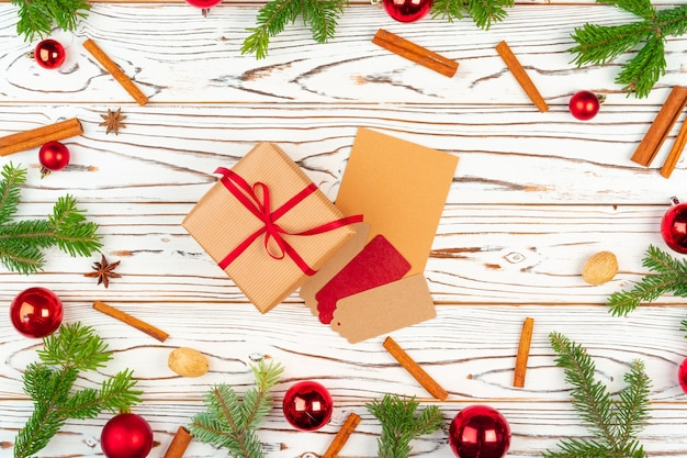Wrapped present on a wooden background with christmas holiday decorations top view