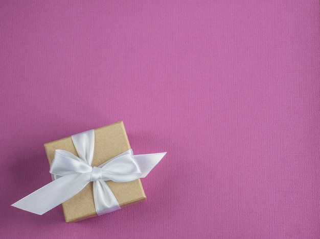 Wrapped vintage gift box. pink background.