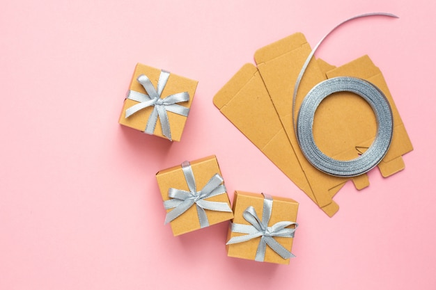 Wrapping gifts concept for holiday on pink background