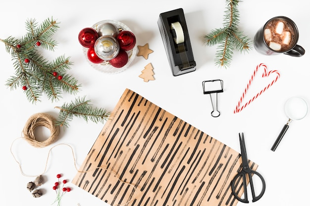 Wrapping paper with fir tree branches on table
