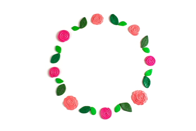 Wreath of flowers and leaves on a white background