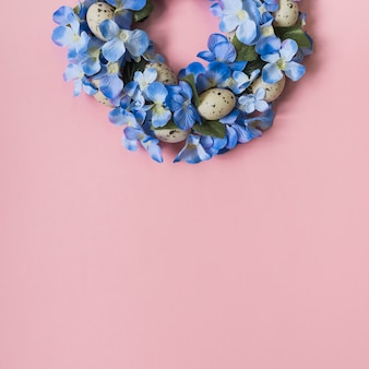 Wreath made from bright flowers and eggs