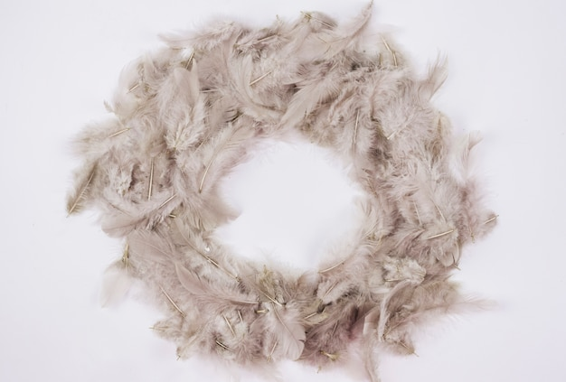 Wreath made from feathers on table