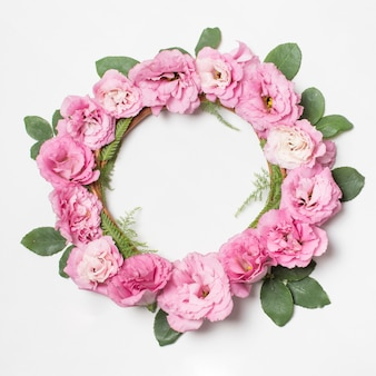 Wreath of rose flowers and green plants