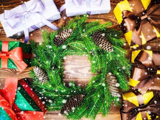Wreath on the wooden board. wrapped gift boxes. christmas
