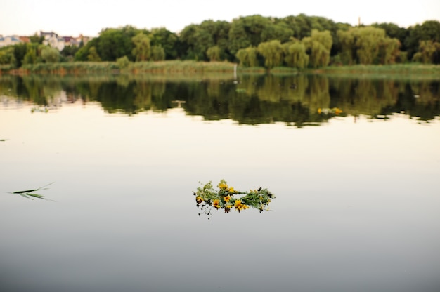 Wreaths of wild flowers on the water