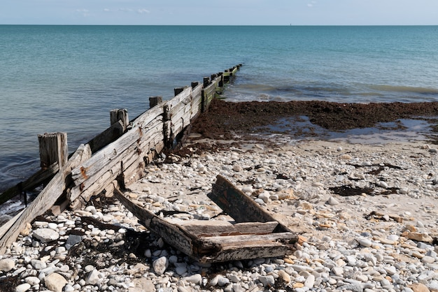 Wreck of wooden boat on beach in cap ferret arcachon bay in france