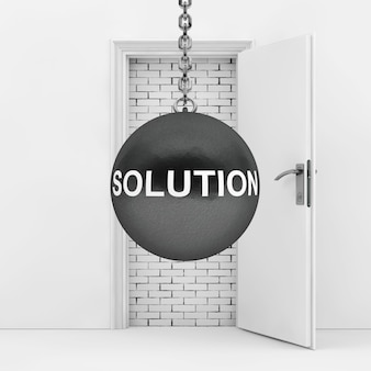 Wrecking ball with solution sign ready to destroy brick wall wich blocked door extreme closeup