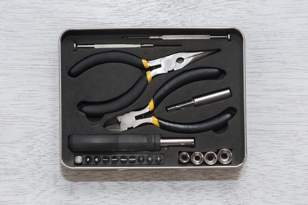 Wrench set on pliers socket spanner and screwdriver tools on white wooden