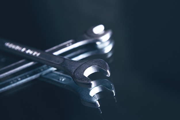 Wrenches on dark surface