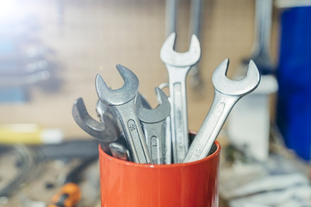 Wrenches in a red container