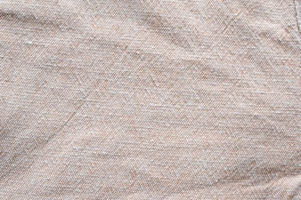 Wrinkled brown cotton fabric textured background