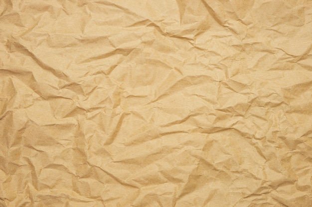 Wrinkled brown paper background. kraft paper texture for wrapping. eco-friendly packaging concept.